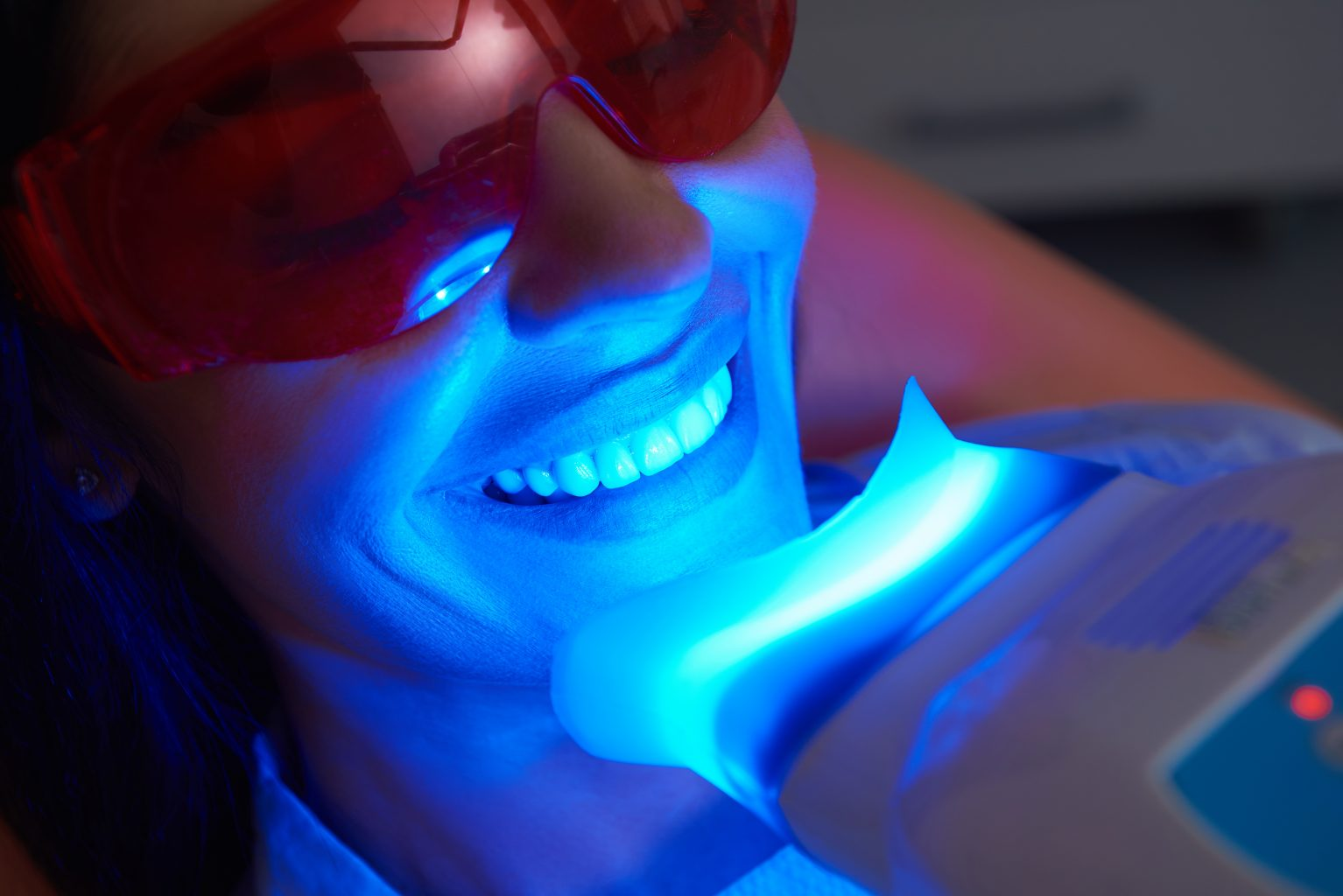 adult woman is doing teeth whitening procedure